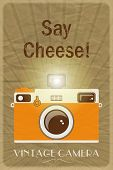 Retro photographic poster with the slogan Say Cheese!, on crumpled brown paper background. EPS10 vec