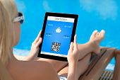Girl Lying On A Deck Chair By The Pool And Holding A Tablet With Mobile Wallet And Liner Ticket On A