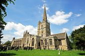 stock photo of church-of-england  - St John the Baptist church Burford Oxfordshire England UK Western Europe - JPG