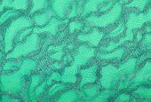 stock photo of spandex  - Green lace on green spandex background macro view - JPG