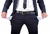 pic of unemployed people  - Businessman standing isolated on the white background and showing his empty pocket turning his pocket inside out no money - JPG