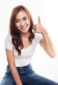 stock photo of thumb  - Happy smiling Asian woman showing thumbs up sign - JPG