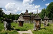 foto of farmworker  - Medieval wooden church with old apiary Ukraine, Pirogovo park, unesco heritage site,  Europe ** Note: Soft Focus at 100%, best at smaller sizes - JPG