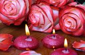 picture of unity candle  - Spa concept with roses and burning candles that float in the water selective focus - JPG