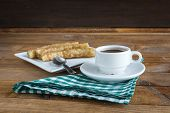 image of churros  - churros con chocolate a typical Spanish sweet snack on old wooden table - JPG