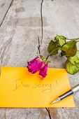 image of condolence  - Dry rose and words of condolence on wooden - JPG