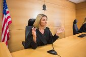 picture of court room  - Stern judge speaking to the court in the court room - JPG
