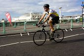 Cyclist Passes Brighton Pier