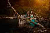stock photo of undine  - Fabulous mythological man and woman sitting in a swamp they love - JPG