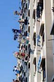 picture of public housing  - Typical Singapore public housing apartments where laundry is hung out to dry on bamboo poles from balconies - JPG