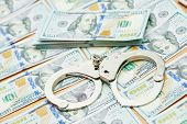 picture of handcuff  - money bribe or corruption theme - JPG