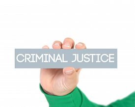 stock photo of flogging  - criminal justice tag hold by woman hand - JPG