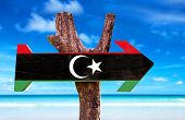 picture of libya  - Libya Flag wooden sign with ocean background - JPG