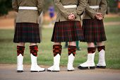 image of kilt  - Three Scottish solders standing dressed in kilts - JPG