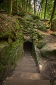 picture of rock carving  - A tunnel carved through the rock along a trail in Hocking Hills Ohio - JPG