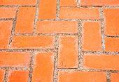 stock photo of paving stone  - Closeup of rectangular orange brick paving stones in a public ground - JPG