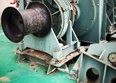 stock photo of fragmentation  - Bow anchor winch fragment with black shaft - JPG