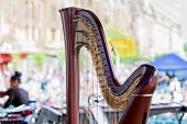 foto of musical instrument string  - Symphony musical instrument called harp with scene background - JPG