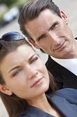 picture of male face  - An outdoor portrait of handsome middle aged man and beautiful young woman couple the focus is on the man in the background - JPG