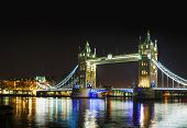 stock photo of london night  - Tower bridge panoramic overview in London United Kingdom at night - JPG