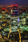 stock photo of london night  - Aerial overview of the City of London financial ddistrict at night - JPG