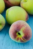 foto of peach  - group of fresh peaches on wood background - JPG