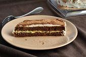 foto of sponge-cake  - Chocolate sponge cake with lemon cream and whipped cream - JPG