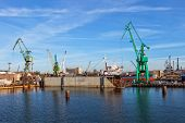 stock photo of shipbuilding  - A view of a large ship under repair in dry dock at a shipyard - JPG