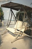 stock photo of lawn chair  - Swing chair in the park with the nature - JPG