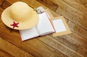 picture of panama hat  - Straw hat with book and red starfish on shabby wooden background - JPG