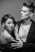 picture of tuxedo  - Young fashionable couple in tuxedos posing in the studio - JPG