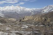 stock photo of mustang  - Landscape of Muktinath village in lower Mustang District Nepal. This photo was shot in early morning. Area was cover by snow. - JPG