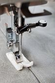 picture of sewing  - sewing machine makes a seam on leather - JPG