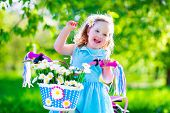 image of cute kids  - Happy child riding a bike - JPG