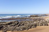 stock photo of tide  - rocks exposed at low tide umdloti beach durban south africa - JPG