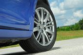 stock photo of alloys  - tire and alloy wheel on this high performance sports car - JPG