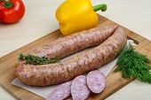 image of raw chicken sausage  - Smoked sausages with dill on the wood background - JPG