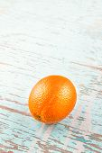 picture of bittersweet  - Fresh Ripe Sweet Orange Fruit on Rustic Grunge Blue Wood Background - JPG