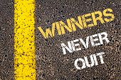 image of quit  - Winners never quit motivational quote.