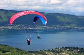 stock photo of annecy  - paraglider flying wing over Lake Annecy, France
