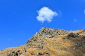 pic of cumulus-clouds  - A little white cumulus cloud seems to be in position over the rocky peak of the Kern River Canyon - JPG