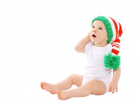 pic of gnome  - Cute baby in the hat gnome sitting and looking up - JPG