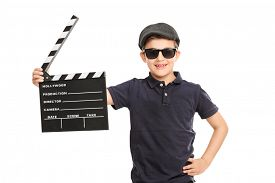 pic of beret  - Little boy with a beret and sunglasses holding a movie clapperboard isolated on white background - JPG
