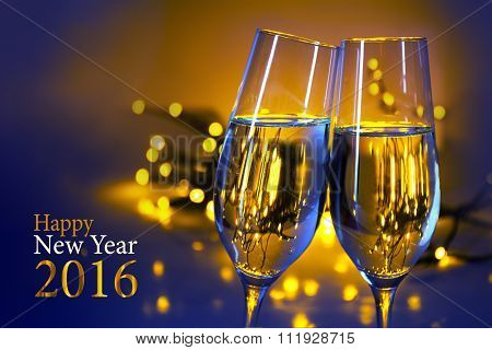 two champagne flutes against blue yellow background text happy new year 2016 poster