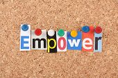 picture of empower  - The word Empower in cut out magazine letters pinned to a cork notice board - JPG