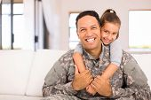 beautiful little daughter and military father at home poster