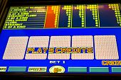 foto of poker machine  - slot machine screen on poker game with cards face down - JPG