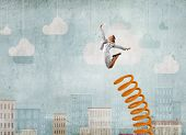 Businesswoman jumping on springboard as progress concept poster