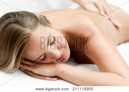 poster of Young Blonde Woman Having Massage In The Spa Salon