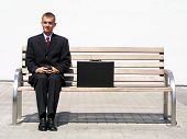 Businessman Sitting On Bench